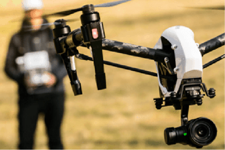 A person controlling a drone - UAV Training Australia