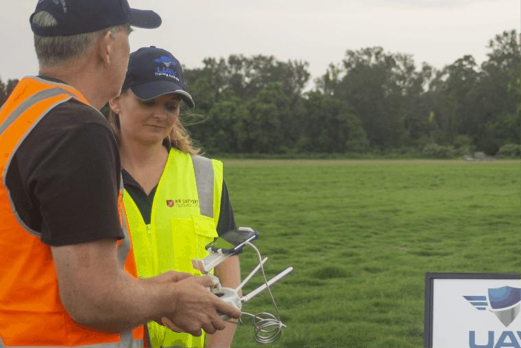 Teacher talking to student on how drones fly -UAV Training Australia